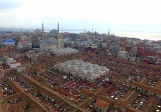 "Aerial photo taken with a drone shows the roof of Istanbul's centuries-old Grand Bazaar, foreground, Monday, Feb. 1, 2016. In a news conference Monday, the municipality of the city's Fatih district announced its plans for the renovation of the iconic maze of shops, restaurants and tea houses. The complex, which houses nearly 4,500 stores, starred in the 2012 James Bond movie, ""Skyfall.""  Historical Nur-u Osmaniye Mosque is in the background. (Ali Aksoyer/DHA via AP)"